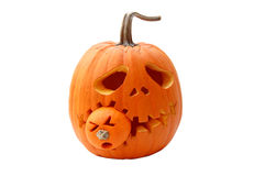Halloween pumpkin. Biting another pumpkin Royalty Free Stock Photo