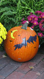 Halloween pumpkin. Closeup of ripe pumpkin decorated with Halloween symbols outdoors Royalty Free Stock Images