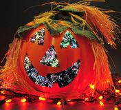 Halloween Pumpkin. Scary Pumpkin on display with Halloween lights stock photo