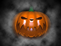 Halloween Pumpkin. Scary Halloween Pumpkin on black with fog Royalty Free Stock Photography