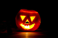 Halloween pumpkin. On a teak table Royalty Free Stock Images