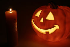 Halloween pumpkin. Candles and halloween pumpkin in the dark Royalty Free Stock Photos