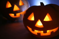 Halloween pumpkin. Double Halloween pumpkin head. Cold back light, scary smiling, warm light inside head stock images