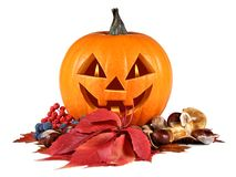Halloween, pumpkin, autumn composition, old jack-o-lantern on white background with fiery flames in the eyes.  stock photos