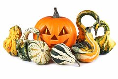Halloween, pumpkin, autumn composition, old jack-o-lantern on white background with fiery flames in the eyes.  stock images