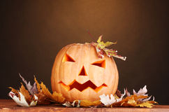 Halloween Pumpkin and autumn leaves Stock Photography