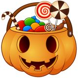 Halloween pumpkin basket with full of candies Stock Photo