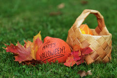 Halloween pumpkin with basket and leaves Stock Image