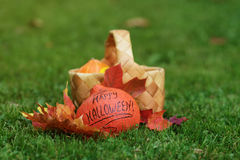 Halloween pumpkin with basket and leaves Royalty Free Stock Image