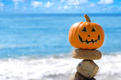 Halloween pumpkin on the beach Royalty Free Stock Images
