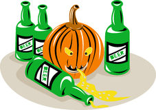 Halloween pumpkin beer bottles Royalty Free Stock Images