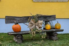Halloween pumpkin on a bench with decorations stock image