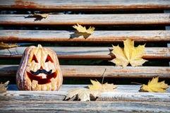 Halloween pumpkin on the bench Royalty Free Stock Photo
