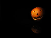 Halloween pumpkin on black background with reflection Royalty Free Stock Photo