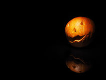 Halloween pumpkin on black background with reflection Stock Image
