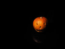 Halloween pumpkin on black background with reflection Royalty Free Stock Images