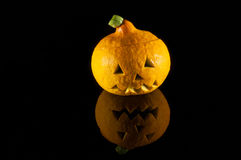 Halloween pumpkin on black mirror Stock Images