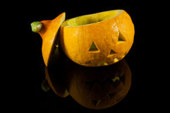 Halloween pumpkin on black mirror. Halloween pumpkin on black reflective background royalty free stock photography