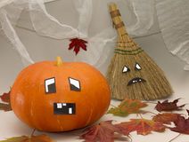 Halloween. Pumpkin and broom with funny faces Stock Images