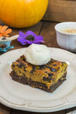 Halloween pumpkin brownie. With vanilla ice cream Stock Images