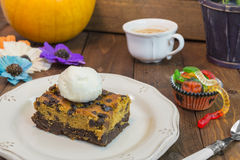 Halloween pumpkin brownie. With vanilla ice cream Royalty Free Stock Images