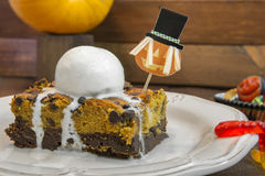Halloween pumpkin brownie. With vanilla ice cream Stock Photos