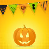 Halloween pumpkin with bunting on an orange background Stock Photography
