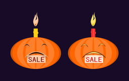 Halloween pumpkin with burning candle on his head and a tag sale in the mouth. Stock Photography