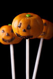 Halloween pumpkin cake pops isolated on a black. Vertical Royalty Free Stock Image