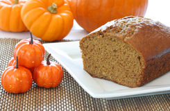 Halloween Pumpkin Cake Surrounded by Pumpkins Royalty Free Stock Image