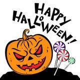 Halloween Pumpkin, candies and text Happy Halloween. Stock Photo