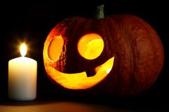 Halloween pumpkin and candle Royalty Free Stock Photography