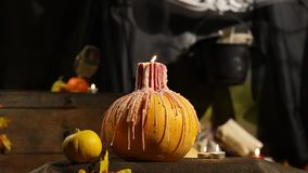 Halloween  pumpkin candle. Windy stock video footage