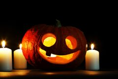 Halloween pumpkin and candles Stock Photography