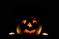 Halloween Pumpkin and Candles Stock Image