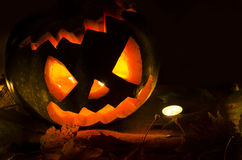 Halloween pumpkin with candles and leaves Stock Image
