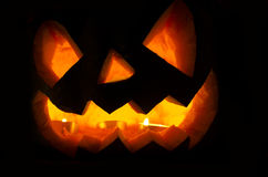 Halloween pumpkin with candles and leaves Stock Photos