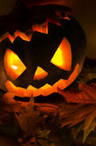 Halloween pumpkin with candles and leaves Stock Photography