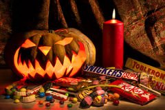 Halloween pumpkin and candy bars Stock Images