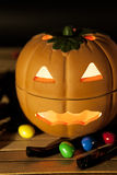 Halloween pumpkin with candy. A clay pumpkin halloween with candy on black background Royalty Free Stock Photography