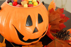 Halloween Pumpkin with Candy. A halloween pumpkin filled with candy from trick or treating Royalty Free Stock Image