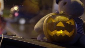 Halloween pumpkin in a car stock video footage
