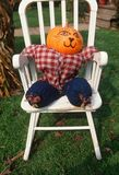 Halloween Pumpkin Character in Chair, New England Royalty Free Stock Photos