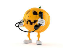 Halloween pumpkin character holding handset. On white background Royalty Free Stock Photo