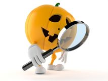 Halloween pumpkin character holding magnifying glass Stock Photo
