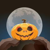 Halloween pumpkin closeup in moon light on a rock Royalty Free Stock Images