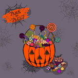 Halloween pumpkin and colorful items. Colorful Halloween poster with sweets and candies bag Royalty Free Stock Photography