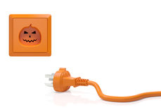 Halloween pumpkin concept. Halloween creative concept. Electric connector (plug adapter) and power socket (outlet) in the form of orange pumpkin with distinctive Stock Image