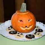 Halloween pumpkin and cookies Stock Photos