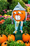 Halloween pumpkin covers her mouth with her hands Royalty Free Stock Photography